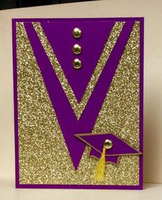 Super sparkly gold glitter paper along with dark purple makes a regal graduation cap and gown.  No punches or dies necessary, just follow the cuts on the card to make your own handmade card. Gold brads and a simple tassel finish the look.
