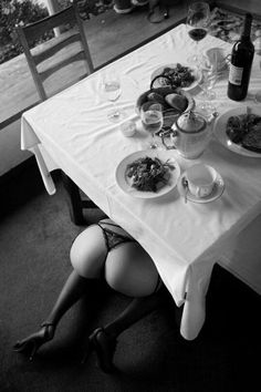 "girl-owner: ""After cooking her Master's meal, the slave should crawl under the table to see to his entertainment. Out To Lunch, Woman Wine, Irish Girls, Under The Table, Nice Asses, Dining Table, Fine Dining, Black And White, Cooking"
