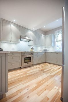 This kitchen was finished with Benjamin Moore Fieldstone #1588 Wellesley Cottages - Toronto - M-Squared Contracting Inc.