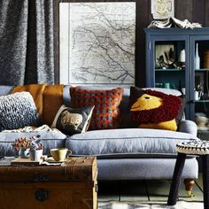 Beautiful gray couch and blue cabinet.  Winter warmers: Decorating with wool  - countryliving.co.uk