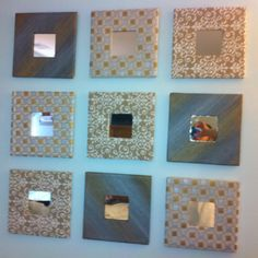 Wall montage with plain Ikea mirrors covered in wall paper from Hobby Lobby