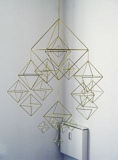 "beautiful HIMMELI - brass mobile. $550.00, by veronika maria via Etsy. // ""Taking the traditional Finnish christmas decoration one step further.   This ""himmeli"" is made of brass tubes and brass wire. It is a beautiful, complex but yet minimal and symmetrical decoration for your house."""
