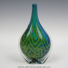 Handcrafted glass vase in the typical blue ochre Mdina colours Made by Mdina Glass on the island of Malta Signed Mdina on the base Measures 22 5cm