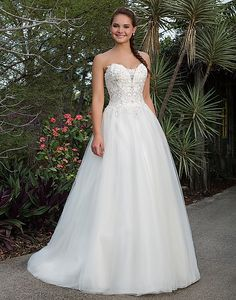 Coming Spring 2016, size 14 Ivory/Silver: Beaded Lace, Tulle Ball gown accentuated by a Sweetheart neckline
