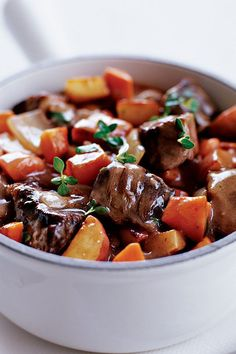 This quick and easy 25-minute beef stew recipe incorporates garlic, carrots, potatoes, dry red wine, thyme, bay leaf and peas to create the ultimate comfort food meets fall recipe. Whether you're eating this stew recipe as a lunch to go or as a quick and easy 25-minute weeknight dinner recipe, it's a great choice for a comfort food recipe.#fallrecipes #comfortfoodrecipes #souprecipes #beefrecipes #stewrecipes #beefstew Boneless Beef Ribs, Vegetable Stew, Favorite Recipes, Best Soup Recipes, Fall Recipes, Beef Recipes, Ginger Beef, How To Cook Beef, Carrots And Potatoes