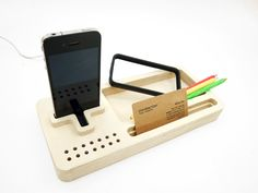 I like this wooden Docktray for the iPod/iPhone and other things that you need closeby. Created by YoungGun Cho.