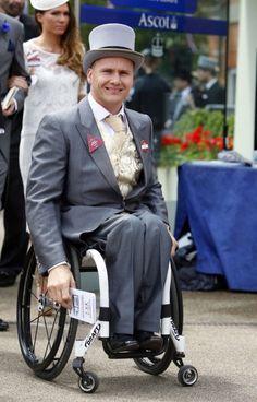 David Weir in morning dress in a wheelchait