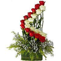L for Love -Bursting with beautiful roses, our striking classic arrangement will fill anybody with all the love in your heart. Arrangement contains 21 Roses. Color Red and White.All items featured on this Web site represent the types of arrangements we offer and may vary depending upon availability in certain regions.