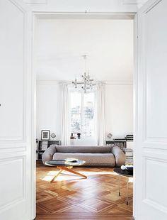 gorgeous oak flooring + a room-stealing sofa.
