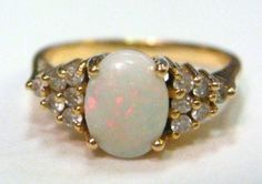 October birthstone engagement ring: Opal and Diamond Engagement Ring from Trocadero, $300