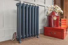 Electric Gladstone cast iron radiator in Farrow & Ball Hague Blue.