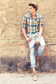 Wear a multi colored tartan button-down shirt with baby blue ripped skinny jeans for a comfortable outfit that's also put together nicely. Complement this look with khaki suede desert boots.   Shop this look on Lookastic: https://lookastic.com/men/looks/multi-colored-long-sleeve-shirt-light-blue-skinny-jeans-tan-desert-boots/14421   — Tan Straw Hat  — Multi colored Plaid Long Sleeve Shirt  — Light Blue Ripped Skinny Jeans  — Tan Suede Desert Boots