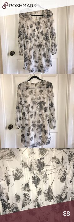 Merona Floral Dress White and gray floral flowy dress with sleeves  Gray floral print  Waist tie Under shirt inside dress Button sleeve and back  Above the knee 100% polyester Perfect condition! Merona Dresses Long Sleeve
