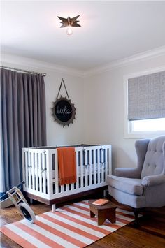Modern Gray and Orange Nursery - love the mod accents + simplicity of this sweet space!