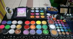 Hazel Wood's face painting set up, over sixty vibrant colours