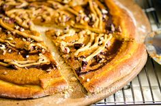 Sweet Pumpkin Pizza Crust 1 T. Active Yeast ½ C. Warm Water 1½ Tbsp. Agave Nectar 2 Tbsp. Olive Oil 1 t Vanilla Extract 1½ C Flour 1 t Ground Cinnamon ¼ t Salt Cornmeal for dusting Crust Glaze 1 T Maple  ¼ tsp. Ground Cinnamon Pumpkin Spread ¾ C. Pure Pumpkin Puree ¼ C. Maple Syrup 1 tsp. Vanilla Extract ¾ tsp. Ground Cinnamon Pinch of Salt Peanut Butter Sauce 2 Tbsp. Creamy Peanut Butter 2 Tbsp. Non-dairy Milk 1 tsp. Vanilla Extract 1 t Maple Syrup Toppings ⅓ C Chopped Pecans Chocolate…