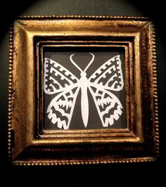 A beautiful paper moth by Frubean Art has been made by the free hand style of paper cutting In a gilded frame strung onto a gold ribbon This is an