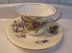 The pattern is lovely, delicate flowers on a pale yellow with a striking crisp white interior of the cup. The flowers are springlike Violets with leaves. Cup And Saucer Set, Violets, Tea Cups, Dishes, My Favorite Things, Deco, Tableware, Handle, Ebay