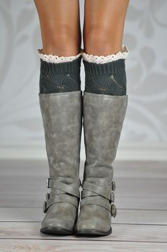 DARK GREY GEOMETRIC BOOT CUFFS Boot cuffs make your boots stand out every time! These lovely gray knitted boot cuffs are the perfect accessory to your favorite boots adding a nice touch with the scalloped white lace around its top rim. The geometric knitting pattern adds a unique look to these hand crafted soft cuffs.
