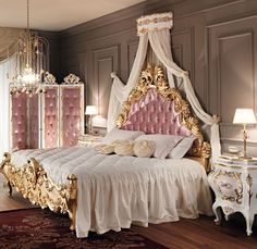 Luxury bedroom.Love the pink & gold, also like the shape of dimpled dressing screen and bedhead, the canopy and the fringing either side of the bed. #homedecorideas #luxurybedroom #interiordesign