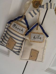 Pair of 'Beach Life' shabby primitive hanging beach huts . Cream cotton beach hut with a cream sign above the door hand-stamped with the word 'Life' and backed with a natural hessian fabric. And a blue & cream ticking fabric beach hut with 'Beach' . Beach Crafts, Kids Crafts, Sewing Crafts, Sewing Projects, Lavender Bags, Lavander, Fabric Houses, Beach Themes, Fabric Scraps