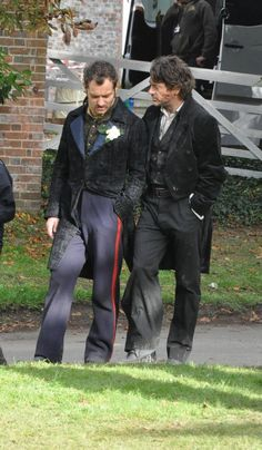 """Jude Law and Robert Downey Jr. during filming of Watson's wedding scene in """"Sherlock Holmes: A Game of Shadows"""""""