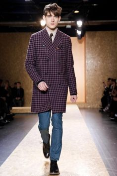 Trend Plaid: Paul Smith's fall/winter 2014 menswear collection in Paris was a punk/rock colour scheme. Using the black and red plaid, in the long double breasted coat, with blue skinny leg pants, it really makes this look very fresh and dark at the same time.