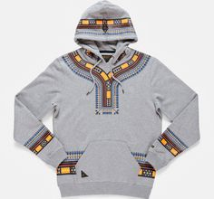 This picture shows a hoodie with Dashiki print. This is an example of cultural appropriation because Dashiki print is mainly from West Africa and Ghana and the fact that is has been put on a Western hoodie shows that it has been appropriated. African Clothing For Men, African Print Fashion, Fashion Prints, Ethnic Fashion, Urban Fashion, Women's Fashion, African Print Shirt, African Shirts, African Attire