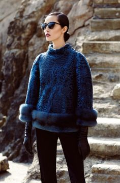 Holt Renfrew Furs: Broadtail pullover with matching Russian sable trim in denim blue, designed by Norman Ambrose. $16,500.