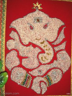 this is a pillayar made out of pearls.i took 2 days to do this and landed up by getiing severe pain at my neck and back.but after seeing the finished muthu pillayar i feel very happy. By saka on www.iKolam.com