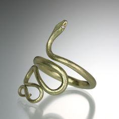 "An 14k green gold, large snake ring with tiny diamond eyes. From head to tail, the snake measures approximately 1.2"" long. Size 7.25."
