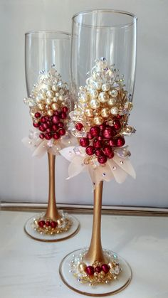 Wedding glasses personalized Burgundy toasting flutes Champagne flutes Wedding gassesivory beige and burgundy Wedding flutes Set of 2 For these : Color - ivory, beige (dark tan) and burgundy All completely handmade! MEASUREMENTS: -Champagne flutes : Height - 9.2 inch (23.5 sm). Volume – 170ml (6.1 oz) Custom champagne glasses may be created to fit your needs. Your unique wedding colors can be used for this design. Names and date may be painted to customize to your occasion. Glasses will be…