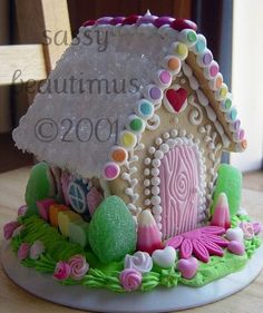 I do not like gingerbread, so here, created by Sassy Beautimus (by way of CakeWrecks), is a SUGAR COOKIE HOUSE. The pastel wood-grain door! The rainbow roof edging! The tiny gumball bushes! So much gorgeousness!