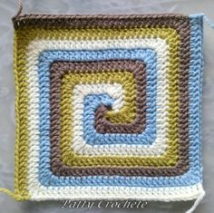 Spiral squares - I may have to try this... a bunch of these together in various sizes could make a fun blanket!