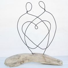 Driftwood and Wire have been lovingly pieced together to create this beautiful, loving couple sculpture. The driftwood was shaped by the Fraser River in Canada and is left in its natural state. The wire figures were hand crafted by myself from a single length of wire, to signify the beauty of a new family.  This piece is approx 8.5Wide x 9.5Heigh x 2.5Deep  Inspiration comes from many places and all my work is done free hand, without the use of plans, jigs, forms and vinyl. To be honest…