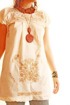 I love the tone on tone of this Mexican style top.  Would look super cute as an embroidered top for baby cakes!