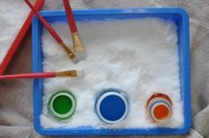 Snow painting. Bring in snow in a tray, add paint, let children create.