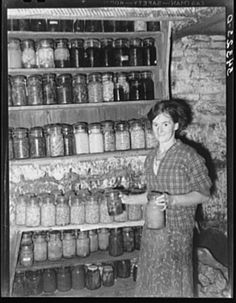 FSA (Farm Security Administration) client with canned goods. Farm, Bradford, Vermont, Orange County. October 1939. Photo by Russell Lee.