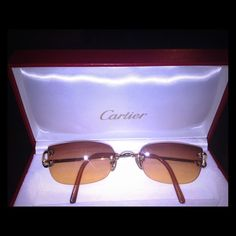 AUTHENTIC CARTIER TIMELESS (SUN)GLASSES FRAME Timeless elegant Cartier frame that can be used as glasses or sunglasses.  Sold as sunglasses. I will throw in 2 extra colored lenses as a bonus. Comes in Cartier red box and all the documentation. Absolutely mint condition. Cartier Accessories Sunglasses