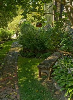Peaceful Shady Garden...old brick walkway...hostas...old weathered bench...birdhouse.