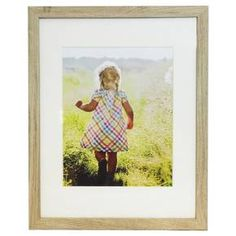 Light Woodtone Gallery Frame by Room Essentials will showcase your most adored moments in a modern yet timeless frame with a rich wood texture. This gallery-style presentation works well in any space with its classic design and professionally matted look.  11x14in matted to hold a 8x10in image.