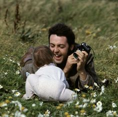 Paul McCartney with his daughter Mary, 1970