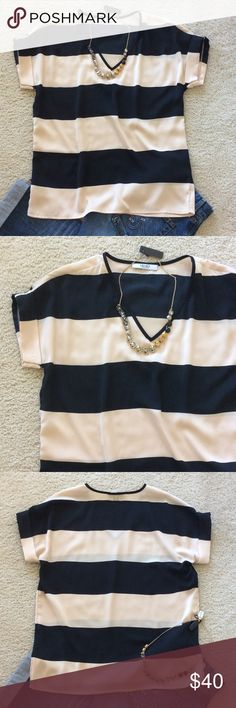 """{Liu Jo} Rugby Stripe top {Liu Jo} Rugby Stripe top. Super cute black and cream color stripes. V neck. Short sleeves. More of a boxy, loose fit. Great with skinnies. Can be dressed up or down💜 Laying flat approx 26"""" shoulder to hem, approx 20.5"""" pit to pit. 100% polyester. Size IT 40, US 2/XS. NWOT, never worn. Liu Jo Tops"""