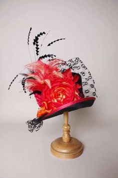"The ""1201KYPS Kelly, parisisal, black with cerise"" hat by Louise Green Millinery. This is one of the hats from the spring - summer 2012 collection."