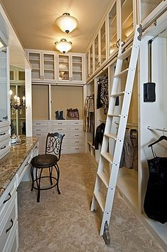 Walk in closet dressing room with ladder. White, narrow. Marble topped make up counter. The ladder makes so much sense and I am sure I can find a place to park it on the end when not in use. Beautiful Closets #matildajaneclothing #MJCdreamcloset