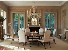 formal dining, crystal chandelier, fireplace, mantel, windows #diningrooms #interiordesign #fireplace