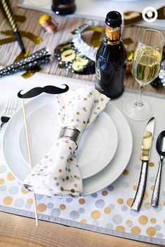 Set your New Year's Eve table with gold and silver accents. Tablecloths and napkin rings keep that table tidy and let's face it, you just can't go wrong with mini-mustache-on-a-stick.