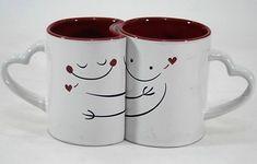 Jogo de 2 (duas) Canecas em Porcelana Branca que se encaixam, Decorados com Carinhas Apaixonadas e Alças de Coração. Parte Interna na Cor Vermelha. Medida: 10 x 8 cm (Diâmetro).