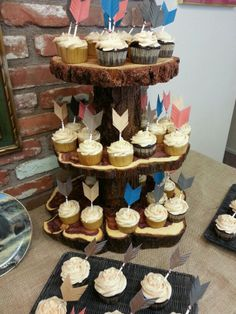 ◇Home made cup cake holder made with scrap log pieces◇ paper, popsicle stick arrows. Native Baby Shower
