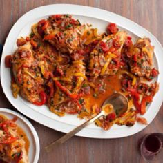 #paleo Giada's Roman Style Chicken: Skinless chicken breasts; ¼ cup olive oil; 1 red bell pepper, sliced; 1 yellow bell pepper, sliced; 2 cloves garlic, chopped; 1 (15-ounce) can diced tomatoes; ½ cup white wine; 1 T fresh thyme leaves; 1 tsp fresh oregano leaves; ½ cup chicken stock